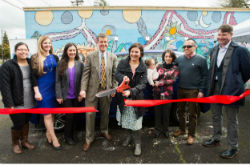 Multnomah County Commissioner Jessica Vega Pederson cuts the ribbon