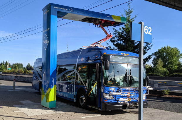 A New Flyer electric bus operated by TriMet recharges at Sunset Transit Center.